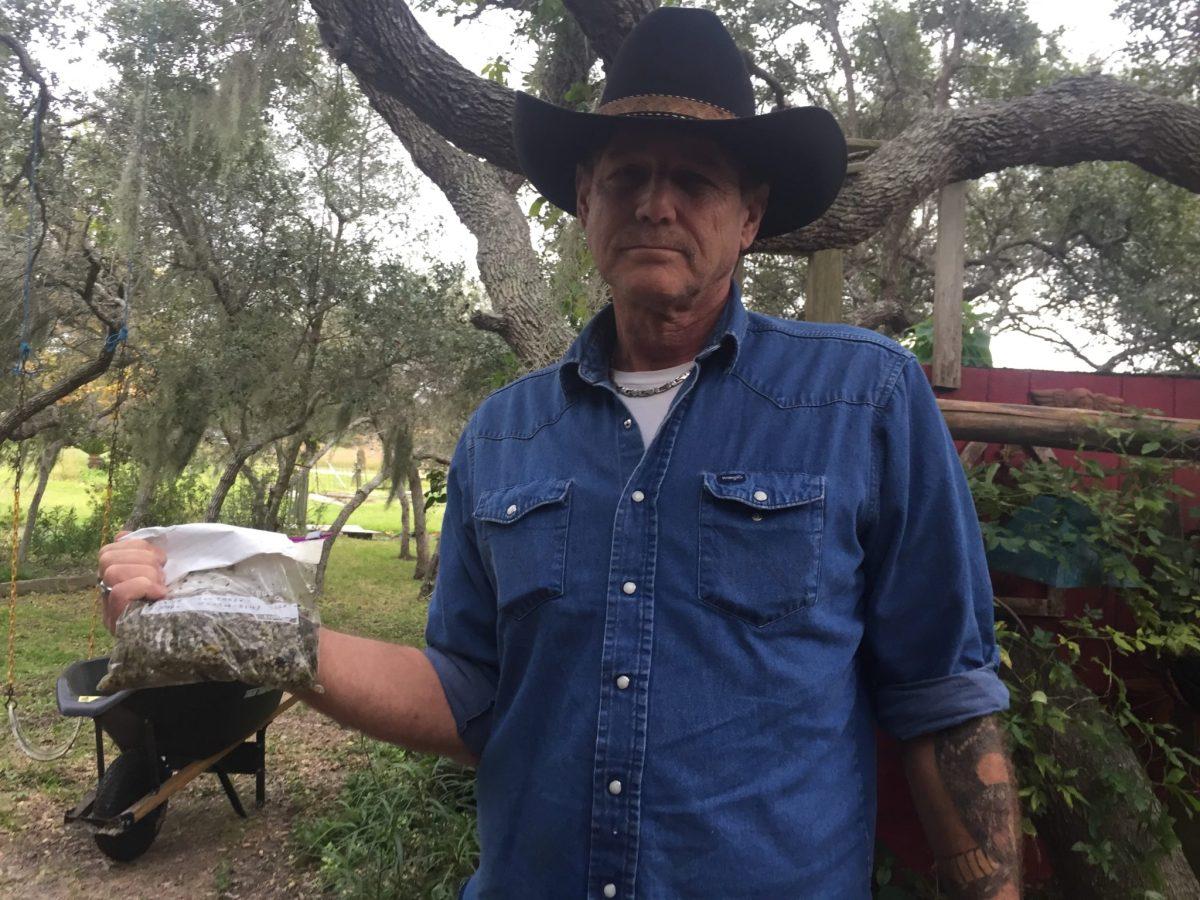 Texas Gulf Coast resident Dale Jurasek, one of the plaintiffs in a case against Formosa Plastics, holds a bag of plastic nurdles.