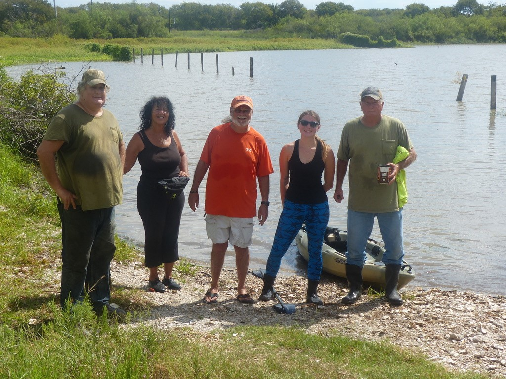 Diane Wilson, leader of the San Antonio Bay Estuarine Waterkeeper group, stands second from left with other group members.