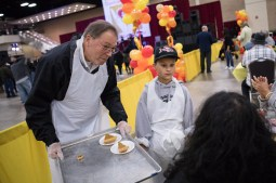 Councilman John Courage (D9) serves pie after the main meal.