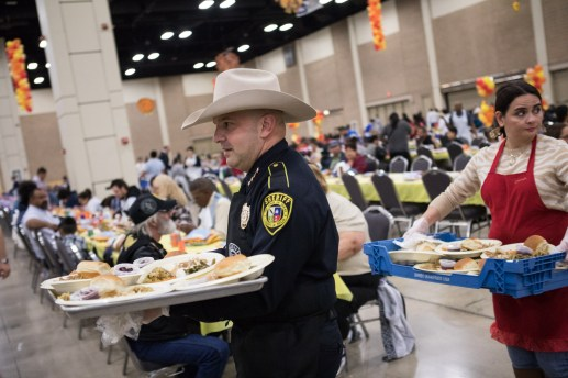Bexar County Sheriff Javier Salazar serves meals to attendees.