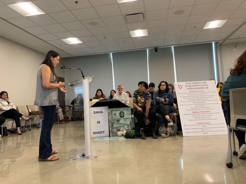 Teri Castillo of the Historic Westside Resident Association addresses the Housing Commission and fellow housing advocates during a meeting regarding the San Antonio Housing Authority's eviction process.