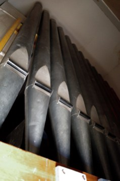 Organ pipes at the church are stored high above the congregation and, to a trained ear, are out of pitch.