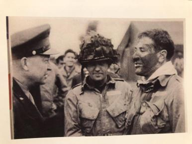 On the night before D-Day, Gen. Dwight Eisenhower (left) confers with Lt. Col. Robert G. Cole (right) and members of the 101st Airborne, 9 1/2 hours before the jump into France.