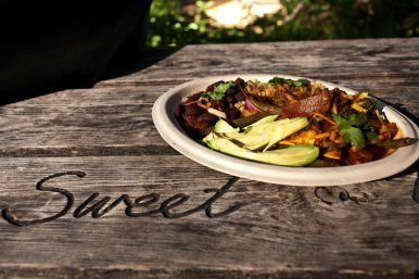 A chef's special includes organic brown rice, red beans, avocado and mixed veggies in a spicy marinara sauce.