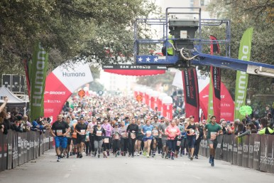 Half-marathon runners begin the race on East Market Street.