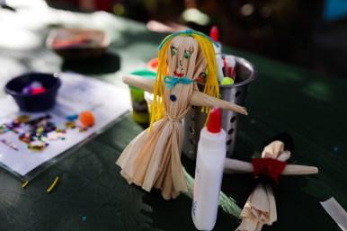 Cornhusk dolls are made at a kids section during La Gran Tamalada.