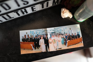 A panoramic photograph of the Rendons' wedding at St. Joseph's Church sits on a shelf near the front door.