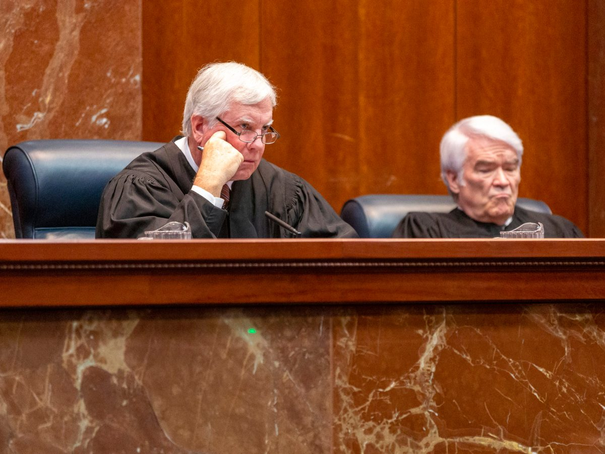 Texas Supreme Court Justice (left) Paul Green and Chief Justice Nathan L. Hecht listen to oral arguments in December 2019.