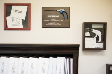Medical tools are attached to awards Gabi Niederauer has won, located in her office.