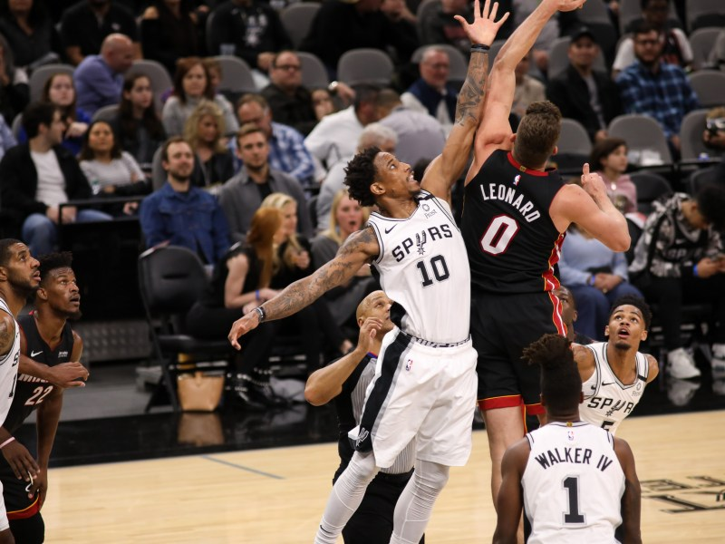 The Spurs' DeMar DeRozan reaches for a loose ball during a home game on Jan. 19.