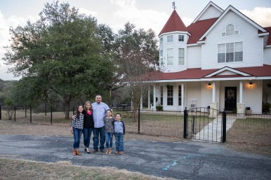 The Benavidez family in front of their home in Helotes.