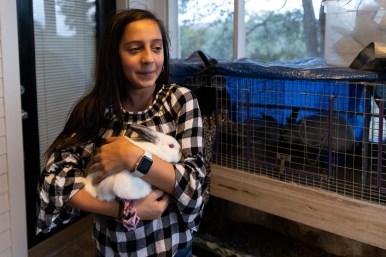 Abbey Benavidez, 12, holds one of the family's rabbits.