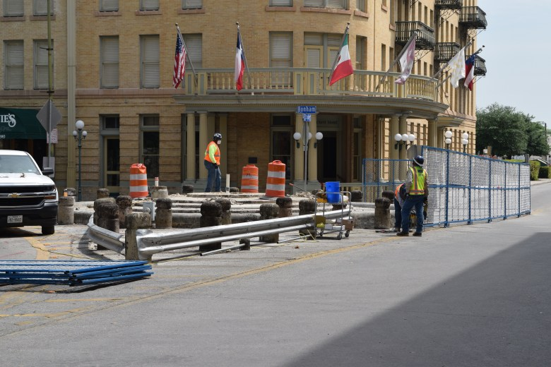 Construction workers finish dismantling the Lady Bird Johnson fountain southeast of the Alamo.