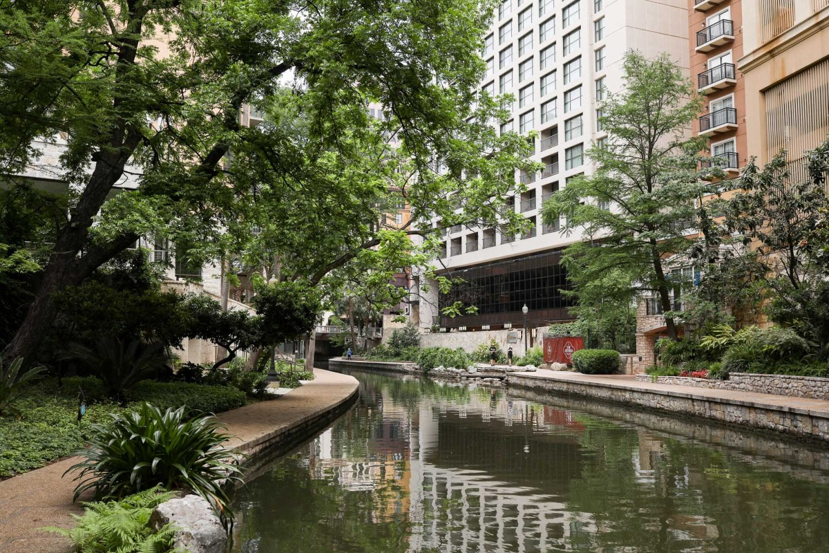 The San Antonio River Walk, typically clustered with thousands, is now nearly unoccupied throughout its reach.