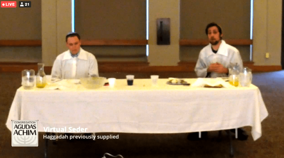 Rabbi Jeffrey Abraham of Congregation Agudas Achim in San Antonio and Assistant Rabbi Ben Richards lead a live-streamed Seder, the first of the Passover season, Wednesday evening in an empty synagogue.