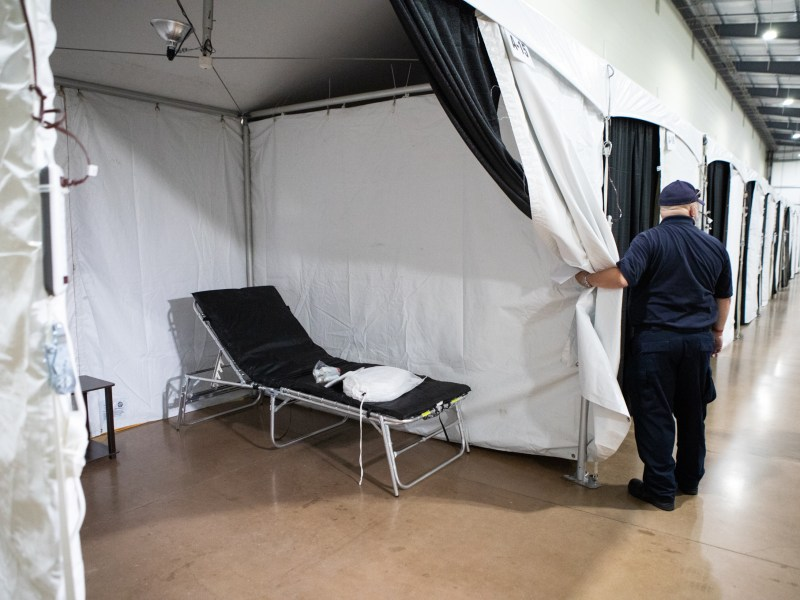 An alternative care facility is set up for non-coronavirus-related patients in an expo hall at Freeman Coliseum.