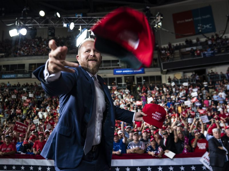 """President Donald Trump's campaign manager Brad Parscale throws out hats before the president arrives to speak during a """"Keep America Great Rally"""" at Southern New Hampshire University Arena."""