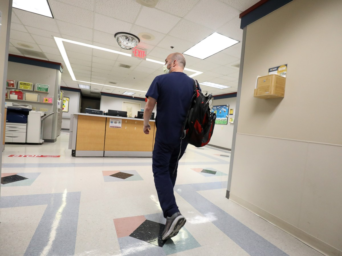 Nurse Manager Adam Sahyouni walks through a wing of Methodist Hospital where an additional section of rooms to treat patients battling COVID-19 has been created.