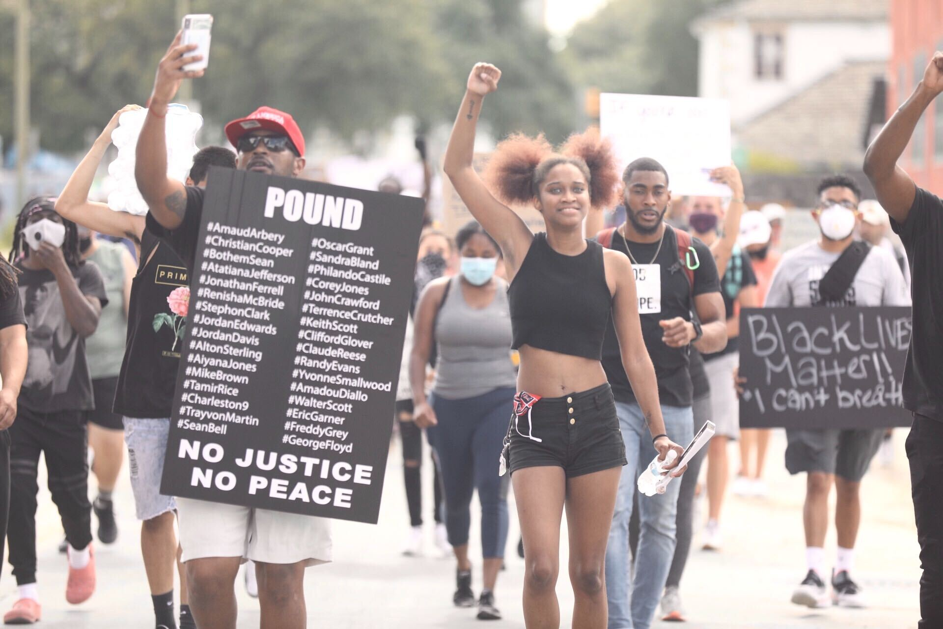 Protesters march during an afternoon demonstration against police brutality in Downtown San Antonio.