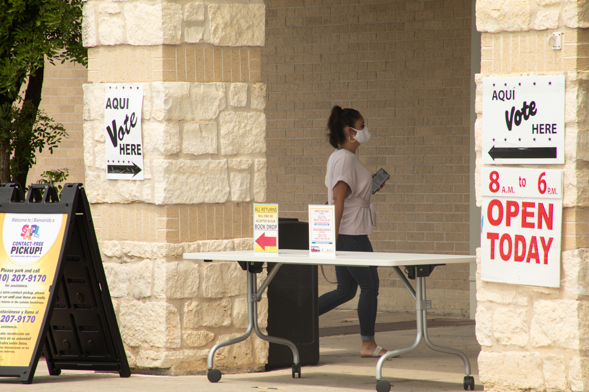 A woman walks into the early voting location at McCreless Library.