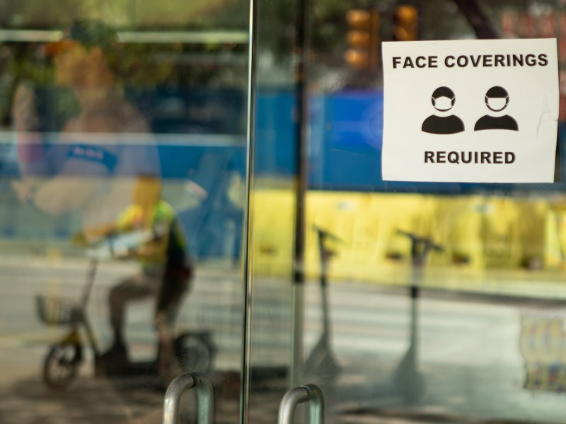 Stores around Alamo Plaza require face coverings to enter.