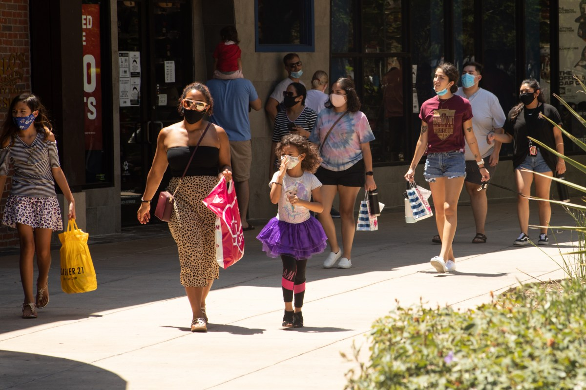 Families wearing masks walk through The Shops at La Cantera. Coronavirus cases among children are rising throughout Bexar County.
