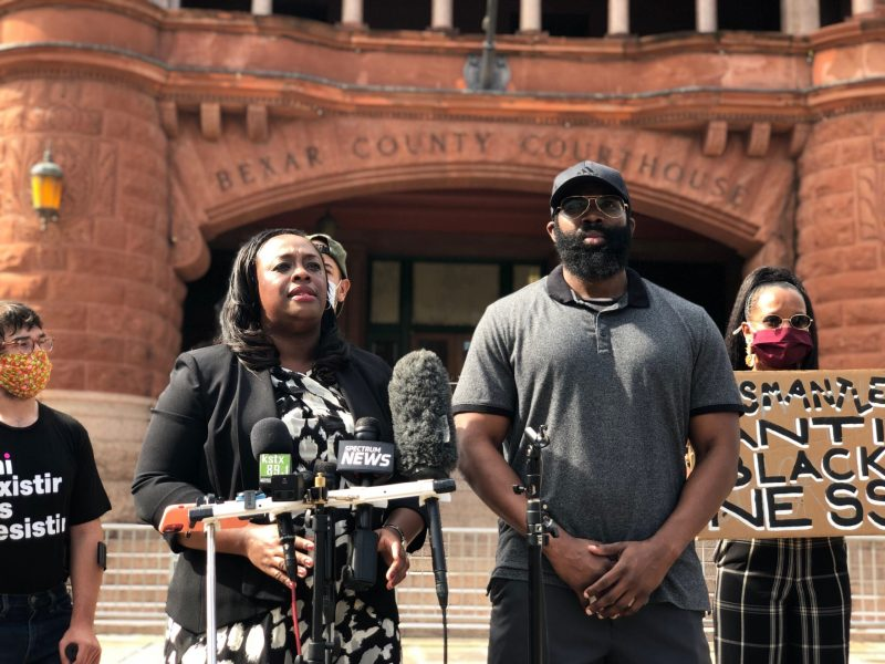 Attorney Artessia House (left) representing Mathias Ometu (right) speaks on behalf of her client outside the Bexar County Courthouse during a press conference last year.