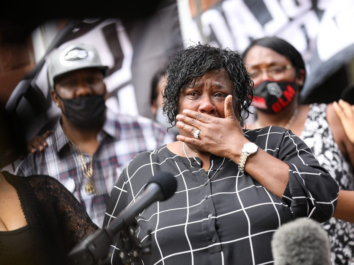 Debbie Bush wipes tears after she and other members of Jones' family met with District Attorney Joe Gonzales to discuss the case for her nephew Marquise Jones, who was shot and killed by an off-duty police officer in 2014.
