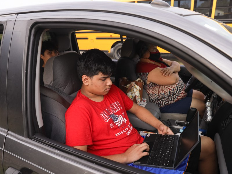 Without home internet, the Lopez family utilizes WiFi from a Southside ISD school bus parked on a vacant lot along Highway 281 last year.