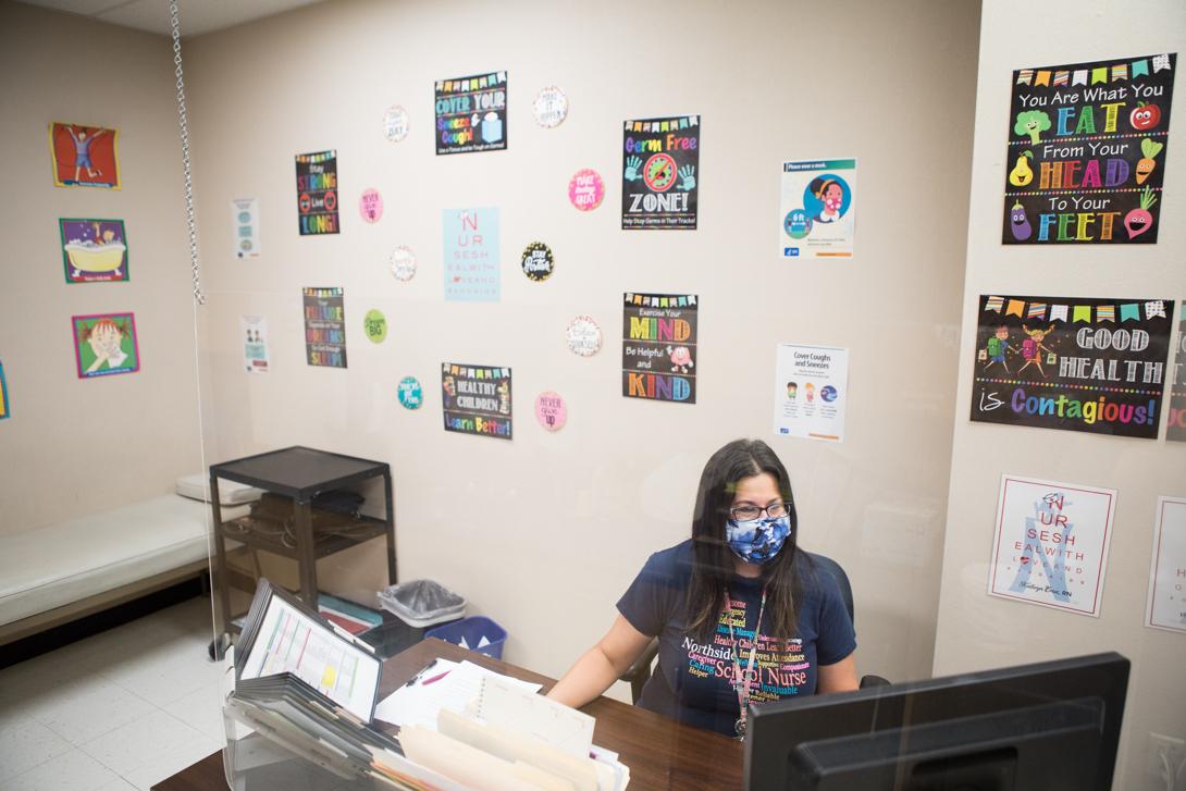 Meadow Village Elementary School nurse Kathryn Cruz works behind her desk in the school clinic.