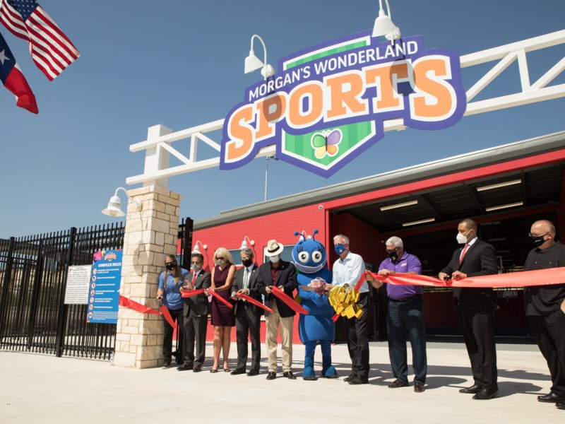 A ribbon is cut to honor the completion of the Morgan's Wonderland Sports complex.
