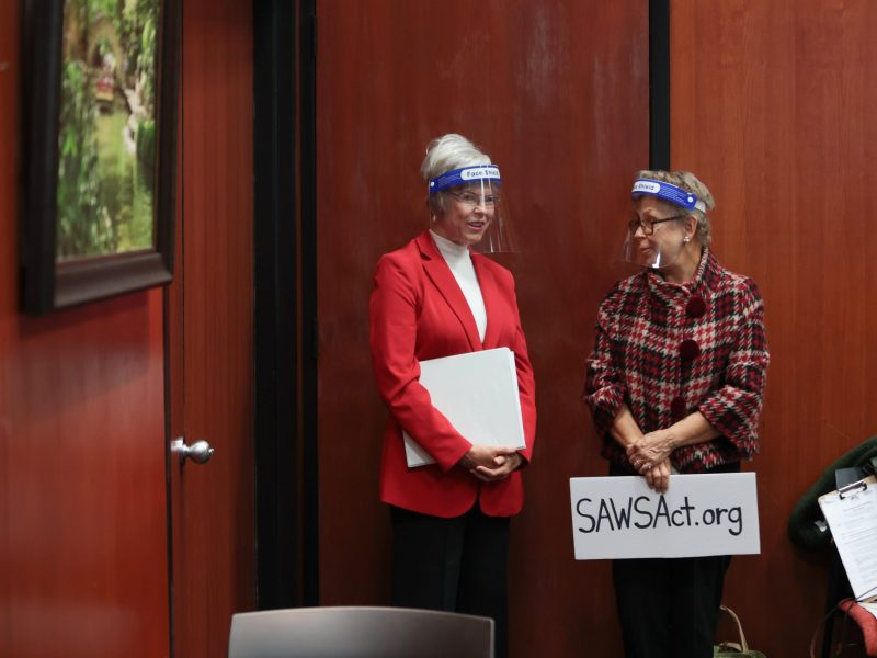 Reinette King, a leader with the SAWS Accountability Act, (left) stands in the room for a press conference from local chamber of commerce leaders opposing the petitions to change the City Charter in October 2020.