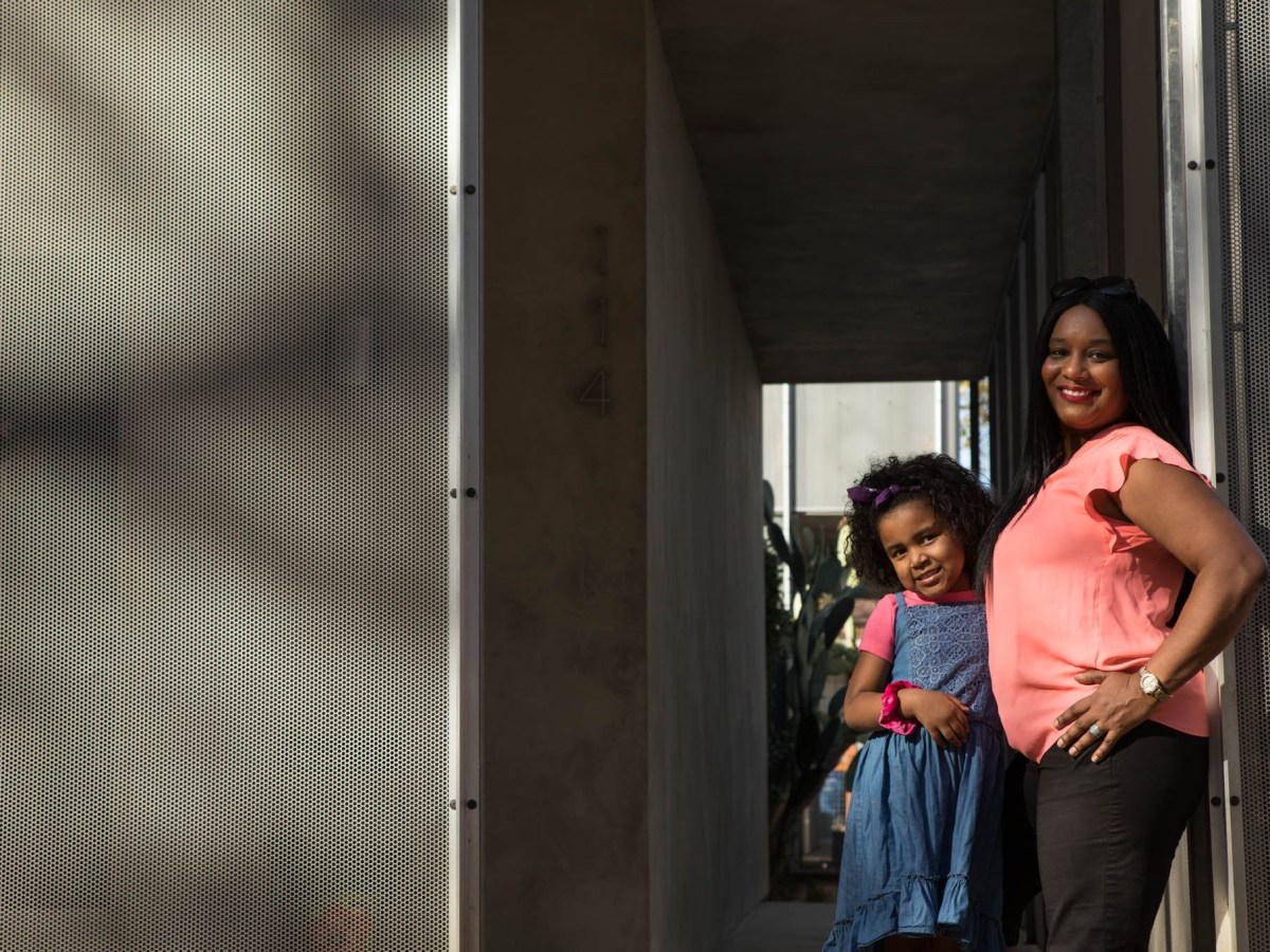 Star Workcuff stands in front of her home with her granddaughter London, 4. Where I Live: Lavaca by Star Workcuff. Photos taken on November 27, 2020.