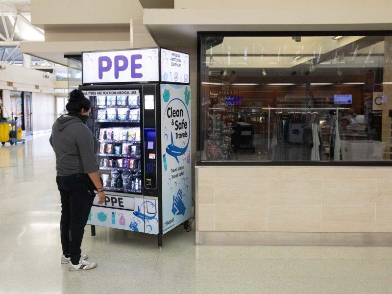 A machine vends personal protective equipment near the TSA security line at San Antonio International Airport's Terminal A.