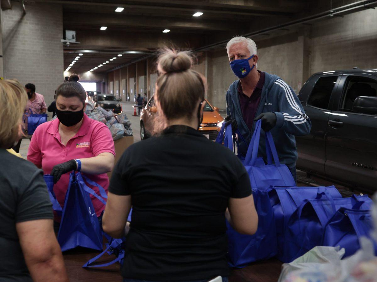Gordon Hartman delivers food during the coronavirus pandemic last November.