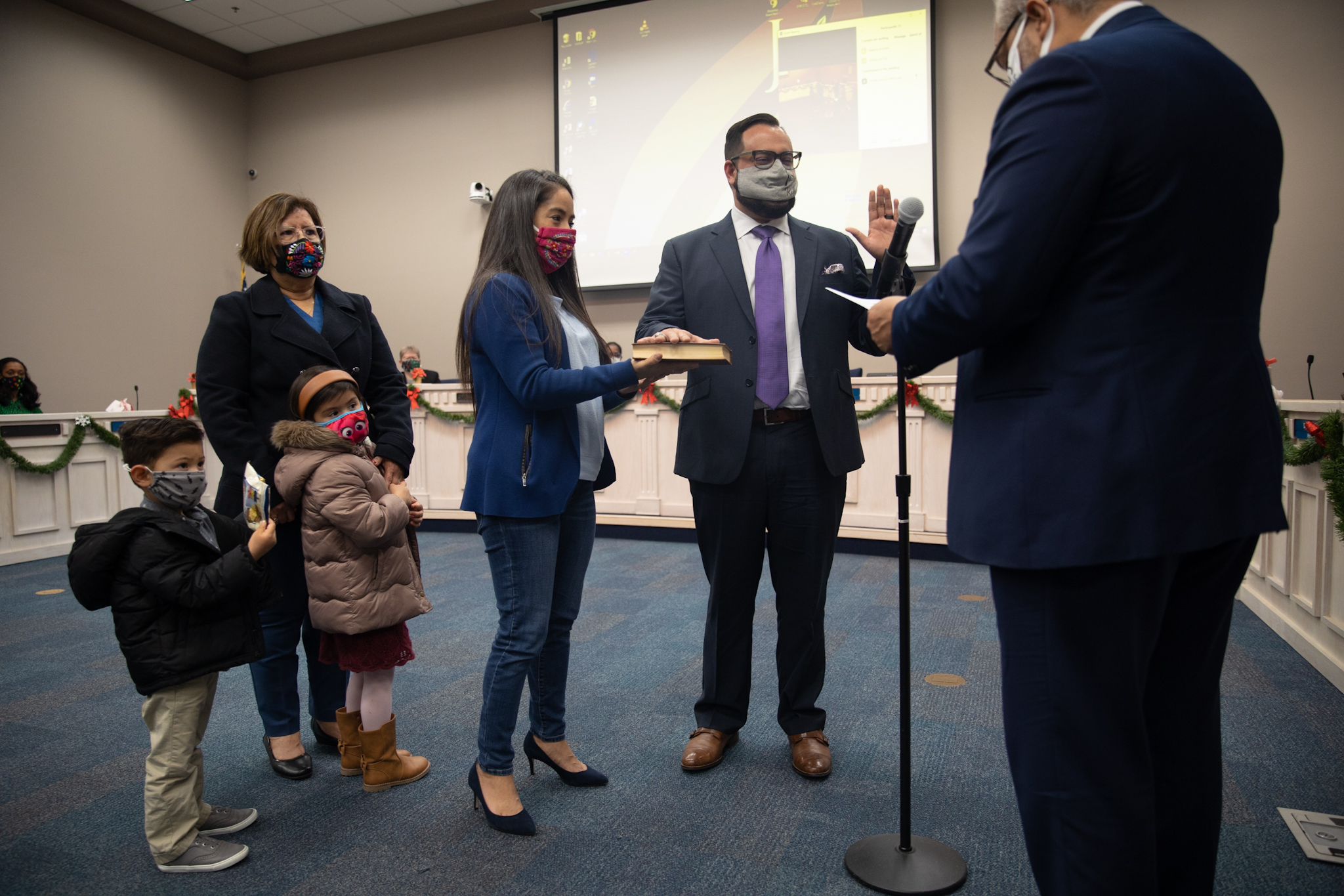 Rafael Diaz is sworn in as Judson Independent School District District 7 trustee with his family by his side.
