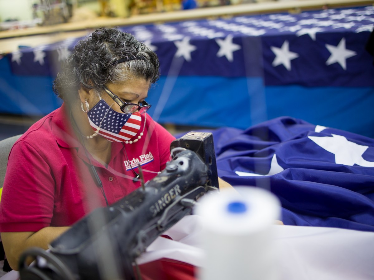 Lucille Rodriguez, a lead seamstress with Dixie Flag and Banner Company, works on an American flag for the upcoming presidential inauguration of President-elect Joe Biden.