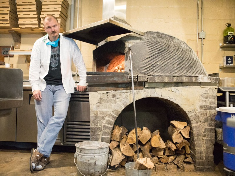 Michael Sohocki stands next to the masonry pizza oven he built for Il Forno. Photos taken for a commentary on December 23, 2020.