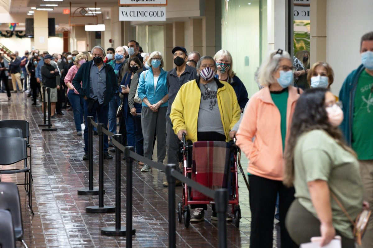 Hundreds of people wait in line at the Wonderland Mall of the Americas, the site of University Health's COVID-19 mass vaccination hub.