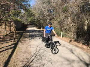 Mitch Hagney passes a row of houses in a shaded residential area in the northern reaches of the Salado Creek Greenway.
