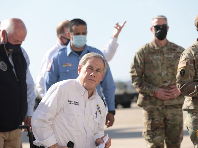 Governor Greg Abbott responds to questions from reporters at Port San Antonio on Sunday afternoon.