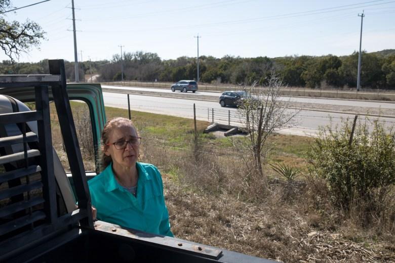 Lynn Graham surveys her land along Blanco Road.