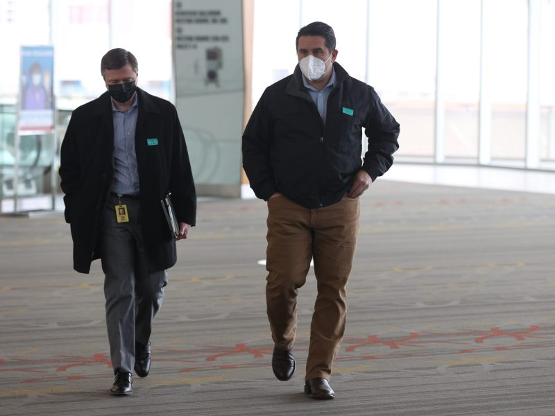 From left, City Chief Financial Officer Ben Gorzell walks with City Manager Erik Walsh before a collective bargaining with the San Antonio Police Officers Association in February.