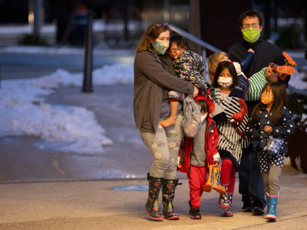 A family seeking shelter arrives at the Henry B. González Convention Center on Tuesday evening.