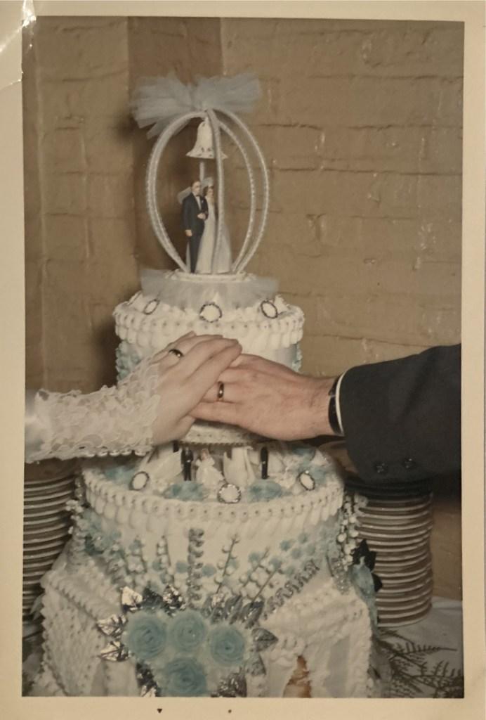 Karen Autenrieth holds Robert Autenrieth's hand on their wedding day to cover up his burn.