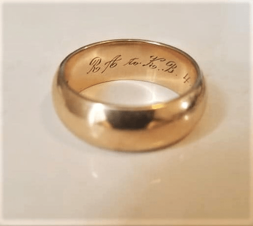 """Karen Autenrieth's wedding band is inscribed the initials """"R.A. to K. B"""" and a date, 4-16-66."""