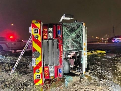 A firetruck overturned early Sunday because of ice.