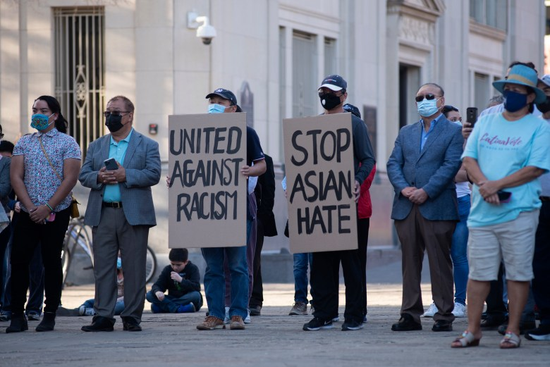 Attendees listen to speakers at the Stop Asian Hate vigil on Saturday.