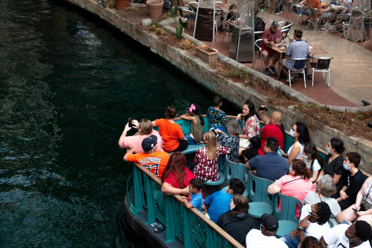 A GoRio Riverboat floats down the San Antonio River full of visitors. While masks are required on the boats, not all were wearing them. Tuesday, March 16, 2021.