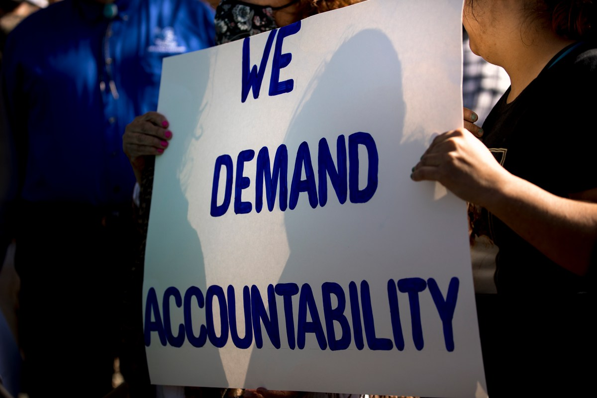 """Demonstrators hold up a sign reading, """"we demand accountability"""" during a press conference outside the Fair Avenue Apartments in San Antonio. City Council formed a new committee that discussed in its first meeting on Tuesday the challenges local utilities face in the wake of the February winter storm and coronavirus pandemic."""